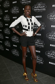 A pair of rose-embellished gold sandals added a glam touch to Alek Wek's look.