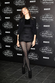 Elisa Sednaoui opted to complete her outfit with a pair of patterned tights instead of a skirt.