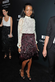Genevieve Jones wore a white lace turtleneck to the global launch of the 2012 Pirelli Calendar.