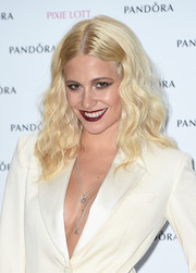 Pixie Lott's vampy red lips looked striking against her white outfit.