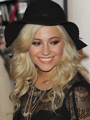 Pixie showed off her fun and playful side in a black sun hat while promoting her clothing line Lipsy.
