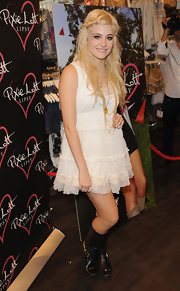 Pixie paired her lace tiered dress with black combat boots.