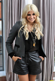 Pixie Lott showed off her pendant necklace, which she paired with a leather shorts and a cropped blazer.