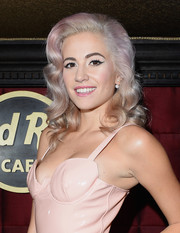 Pixie Lott goes for a retro look in her light purple dyed curly hairdo.
