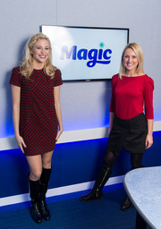 Pixie Lott was retro-chic in black Saint Laurent patent boots teamed with a mini dress while visiting Magic FM.