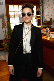 Jenny Slate sported a pair of round shades while posing for photographers at the Sundance Pizza Hut Lounge.
