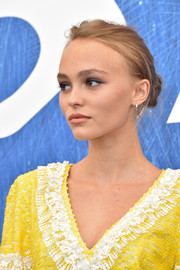 Lily-Rose Depp kept it casual with this loose bun at the Venice Film Festival photocall for 'Planetarium.'
