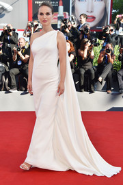 Natalie Portman looked radiant in a white Christian Dior one-shoulder gown with a watteau train at the Venice Film Festival premiere of 'Planetarium.'