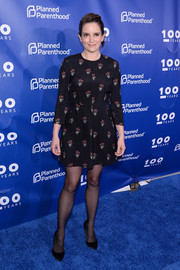 Tina Fey looked youthful and chic in a printed mini dress by A.L.C. at the Planned Parenthood 100th anniversary gala.