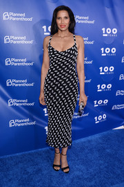Padma Lakshmi polished off her look with a pair of black satin sandals.