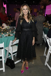 Sarah Jessica Parker added a pop of color with a pair of hot-pink satin pumps.