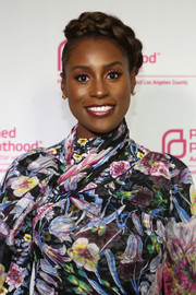 Issa Rae styled her hair into a romantic braided updo for the Politics, Sex & Cocktails event.