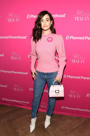 Emmy Rossum was casual and sweet in a puff-sleeved pink turtleneck and blue jeans at the Sex, Politics, Film, and TV reception.