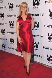 Nina Hartley exuded romance in a shimmery red satin dress.