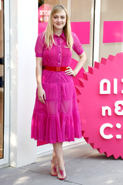Dakota Fanning coordinated her outfit with a pair of clear and fuchsia lace-up mules by Gianvito Rossi.