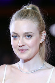 Dakota Fanning accessorized with a pair of delicate diamond studs in one ear.