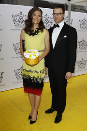 Princess Victoria was a colorful beauty in this richly textured dress—perfect for the yellow carpet.