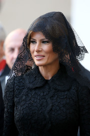 Melania Trump headed to an audience with Pope Francis wearing a black lace head scarf to match her dress.