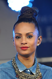 Alesha Dixon performed at the Poppy Appeal concert wearing her hair in a towering braided top-knot.