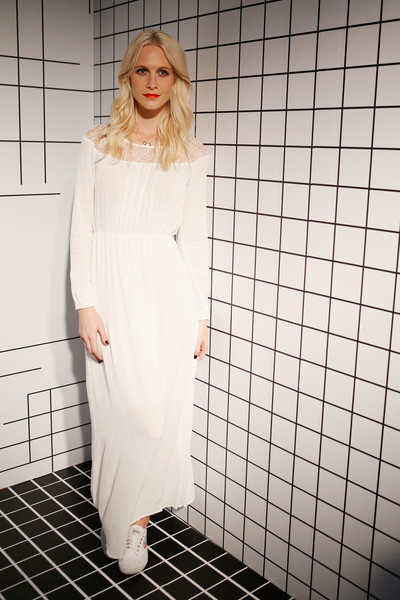 Poppy Delevingne contrasted her girly dress with sporty footwear.