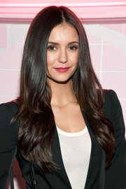 Nina Dobrev looked like she just stepped out of a shampoo ad with her perfect waves at the launch of Pop & Suki.