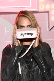 Cara Delevingne showed off her pink Pop & Suki camera bag during the label's launch.