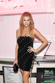 Charlotte McKinney looked saucy in a strapless lace-up mini dress at the launch of Pop & Suki.
