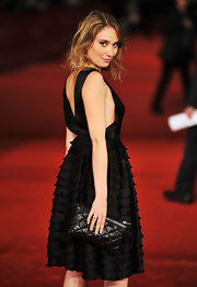 Deborah's quilted leather clutch was a sleek and elegant accessory for the red carpet.