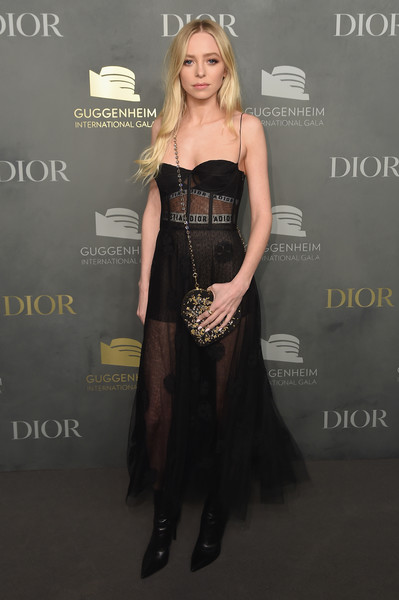 Portia Doubleday Chain Strap Bag [dior,portia doubleday,hair,clothing,dress,shoulder,hairstyle,carpet,strapless dress,fashion,blond,long hair,guggenheim international pre-party made possible,guggenheim international gala pre-party,new york city]