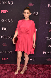 Kate Mara attended the New York premiere of 'Pose' wearing a fuchsia cape-sleeve cocktail dress by Valentino.