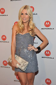 Tinsley Mortimer added an exotic touch to her beaded mini dress with a snakeskin frame clutch.
