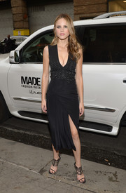 Halston Sage showed off her assets in a mega-plunging LBD during the Lexus Design Disrupted event.