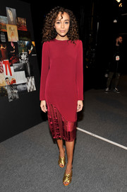 Ashley Madekwe chose a simple yet elegant long-sleeve burgundy silk dress by Prabal Gurung for the label's fashion show.