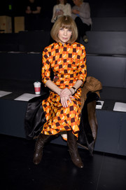 Anna Wintour attended the Prabal Gurung fashion show wearing a brightly hued print dress.