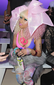 Nicki Minaj wore a pink beaded statement necklace with a large, plastic, pretzel-shaped pendant at the Prabal Gurung spring 2012 fashion show.