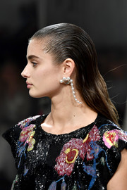 Elegant dangling pearl earrings polished off Taylor Hill's look.