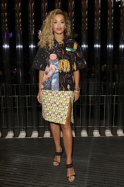 Rita Ora completed her busy-looking outfit with a mod print pencil skirt.