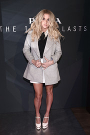 Kesha arrived for the Prada Iconoclasts event looking cozy in a gray wool jacket.