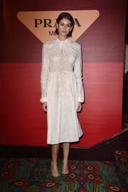 Kaia Gerber went the conservative route in a long-sleeve white midi dress at the Prada dinner.