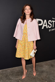 Michelle Monaghan went for a vibrant mix of colors at LA premiere of 'Past Forward,' pairing a pink swing jacket with a yellow and orange floral dress (both by Prada).