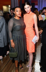 Paloma Elsesser chose a partially sheer midi dress that featured a warped grid print for the Prada Linea Rossa event.