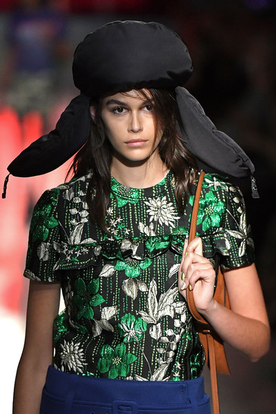 Kaia Gerber accessorized with a puffer aviator hat at the Prada Resort 2019 show.