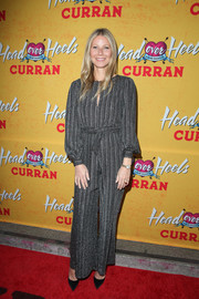 Gwyneth Paltrow attended the pre-Broadway opening engagement of 'Head Over Heels' wearing a striped gray jumpsuit by Retrofete.