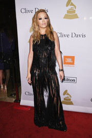 Rita Ora hit the pre-Grammy gala rocking a sheer, fringed jumpsuit by Elie Saab.
