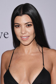Kourtney Kardashian sported a glossy straight hairstyle at the pre-Grammy gala.