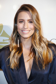 Renee Bargh attended the pre-Grammy gala wearing her hair in stylish boho waves.