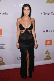 Kourtney Kardashian brought a bondage vibe to the pre-Grammy gala with this strappy, high-slit cutout gown.
