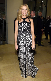 Sheryl Crow looked striking in a monochrome gown with a bold geometric print and a cutout neckline during the pre-Grammy gala.