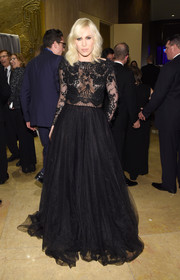 Natasha Bedingfield attended the pre-Grammy gala dressed to the nines in a black gown with a fitted lace bodice and a voluminous tulle skirt.