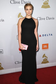 Tori Kelly injected a bright spot with a pearlized pink box clutch by Edie Parker.